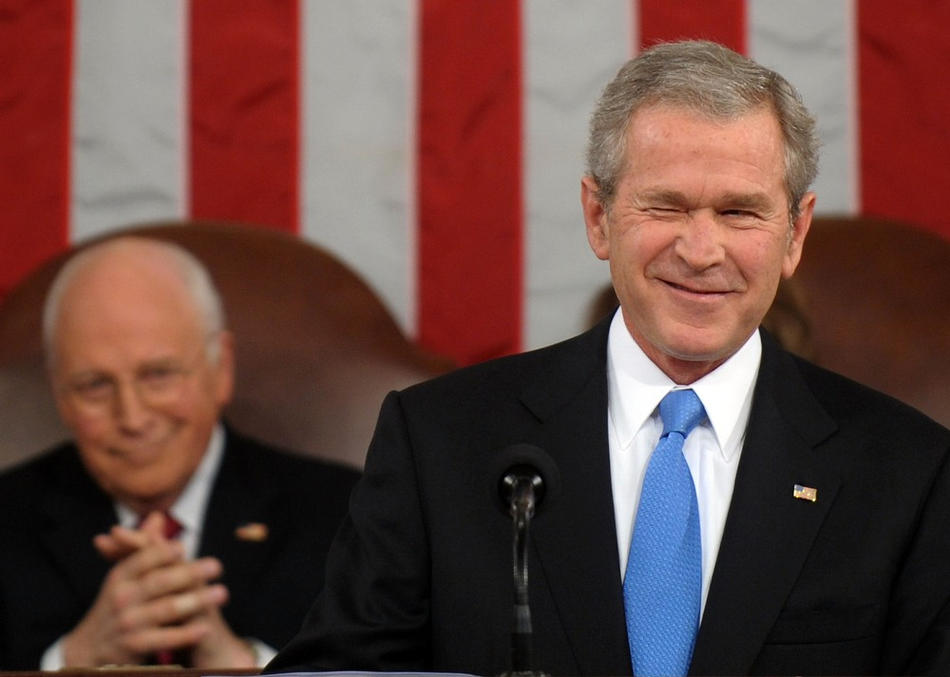U.S. President George W. Bush winks while delivering his final State of the Union address as Vice President Dick Cheney (L) looks on at the U.S. Capitol January 28, 2008 in Washington, DC. Bush, in his last address, spoke on such topics as the uncertainty of the economy, the status of the war in Iraq, and immigration reform.  (Photo by Pool via Getty Images)