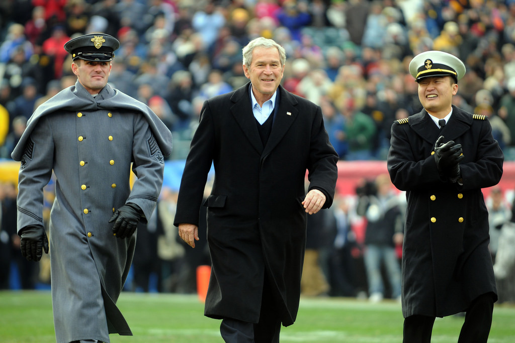 081206-N-5549O-002 PHILADELPHIA (Nov. 6, 2008) President George W. Bush is escorted onto the field by a U.S. Military Academy cadet and a U.S. Naval Academy midshipman before the start of the 109th Army-Navy college football game at Lincoln Financial Field in Philadelphia. (U.S. Navy photo by Mass Communication Specialist 2nd Class Kevin S. O'Brien/Released)(U.S. Navy photo by Mass Communication Specialist 2nd Class Kevin S. O'Brien/Released)